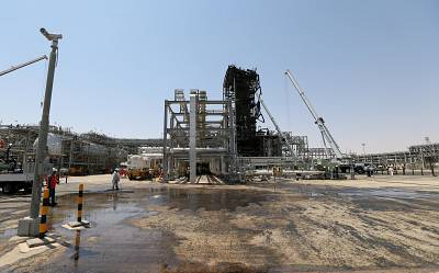 Workers are seen at the damaged site of Saudi Aramco oil facility in Khurais on Sept. 20.