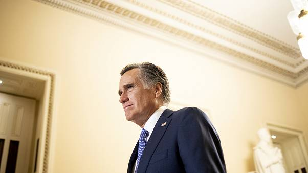 Image: Sen. Mitt Romney, R-Utah, leaves the State of the Union address on F