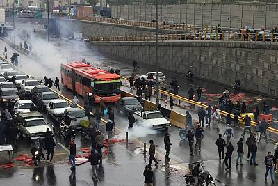 People protest against increased gas price, on a highway in Tehran, Iran, on Nov. 16, 2019.