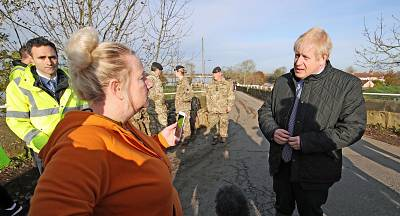 Prime Minister Boris Johnson speaks with a local woman during a visit to Stainforth to see the recent flooding.