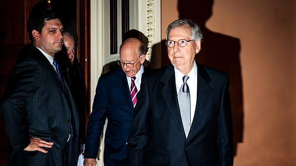 Image: Senate Majority Leader Mitch McConnell leaves a Republican policy lu