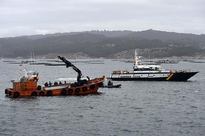Spanish Guardia Civil\'s divers work to resurface the submarine in Aldan, northwestern Spain, on Monday.