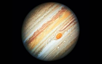 Jupiter\'s Great Red Spot, a giant storm, is large enough to swallow earth.