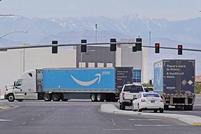 Amazon trucks leave the Amazon regional distribution center on June 6, 2019 in Las Vegas.