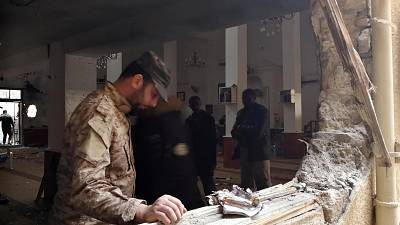 Libya Benghazi mosque bombing kills two wounds 55- medics