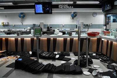 Food trays and other items lay scattered around at a canteen on the Hong Kong Polytechnic University campus in the Hung Hom district of Hong Kong on Nov. 27, 2019, over a week after police surrounded the building while protesters were still barricaded inside.