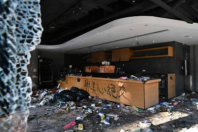 A badly damaged Starbucks coffee shop is pictured on the Hong Kong Polytechnic University campus in the Hung Hom district of Hong Kong on Nov. 27, 2019, over a week after police surrounded the building while protesters were still barricaded inside.
