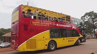 Uganda's open-Roof tourist bus provides Kampala's scenic landscape experience