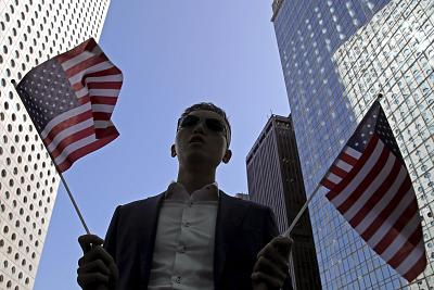 A protester holds American flags during a demonstration in Hong Kong\'s financial district on Thursday.