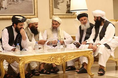 Senior Afghans gather during talks with the Taliban in the Qatari capital Doha on July 8.