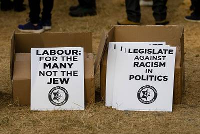 Placards protesting anti-Semitism at a protest in Parliament Square, London on July 19, 2018.