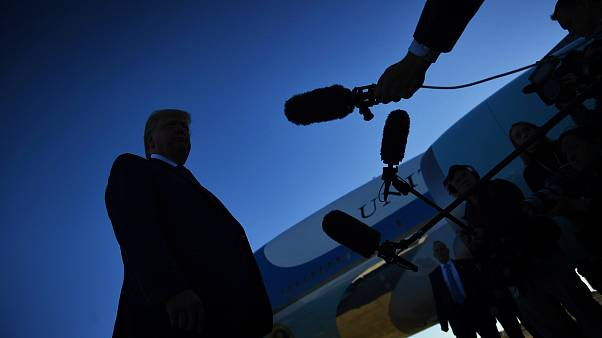 Image: President Donald Trump speaks to the press before boarding Air Force