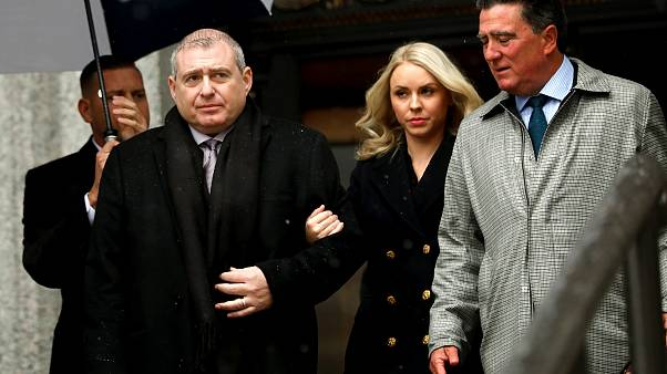 Image: Ukrainian-American businessman Lev Parnas and his wife, Svetlana, le