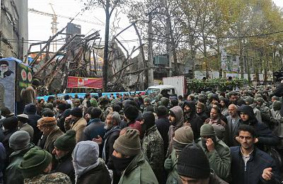 Iranian mourners attend the funeral of Morteza Ebrahimi, a commander of the Islamic Revolutionary Guard Corps, who was killed in violent demonstrations that erupted across Iran last week, on Nov. 20.