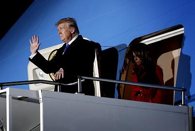 The president and first lady Melania Trump arrive in the U.K. on Monday.