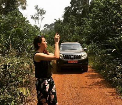 Charlotte Pawar takes photos on a jungle road in Cameroon in a post on her Facebook page.