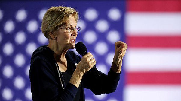 Image: Democratic presidential candidate Sen. Elizabeth Warren holds a town