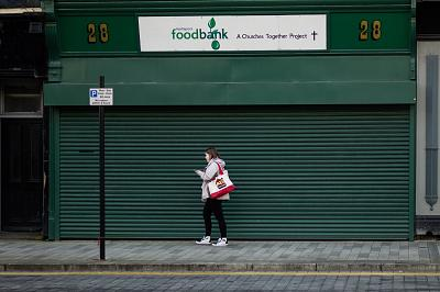 A woman walks past a food bank in Hartlepool.