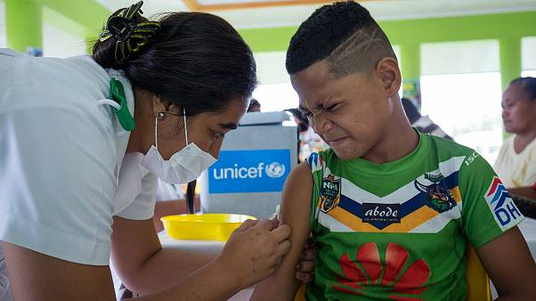 Image: A boy receiving a vaccine during a nationwide campaign against measl