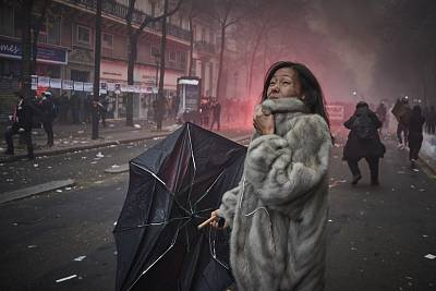 A woman screams amidst clouds of tear gas as protesters and French Riot Police clash during a rally near Place de Republique on Thursday in Paris.