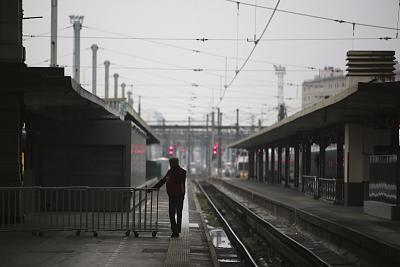 A man stands on a deserted platform at the Gare de Lyon train station on Friday in Paris.