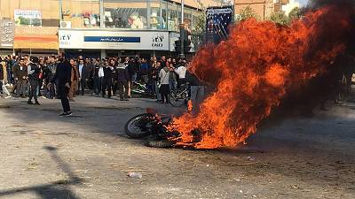 Iranian protesters gather around a burning motorcycle during a demonstration against an increase in gasoline prices in the central city of Isfahan, on Nov. 16.