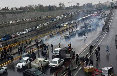 People protest against increased gas price, on a highway in Tehran, Iran Nov. 16.