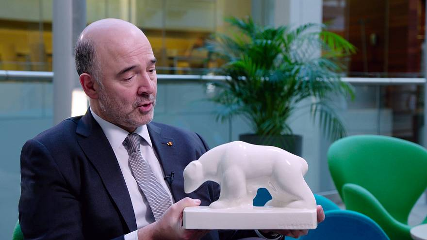 Real Stuff: European Commissioner Moscovici & His Shiny Bear