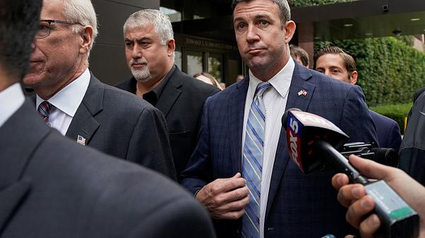 Image: U.S. Representative Duncan Hunter leaves federal court after pleadin