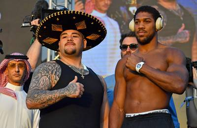 Mexican-American heavyweight boxing champion Andy Ruiz Jr and British heavyweight boxing challenger Anthony Joshua pose during the official weigh-in in the Saudi capital Riyadh on Friday.