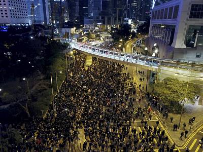 Protesters march into the night in Hong Kong on Dec. 8, 2019.
