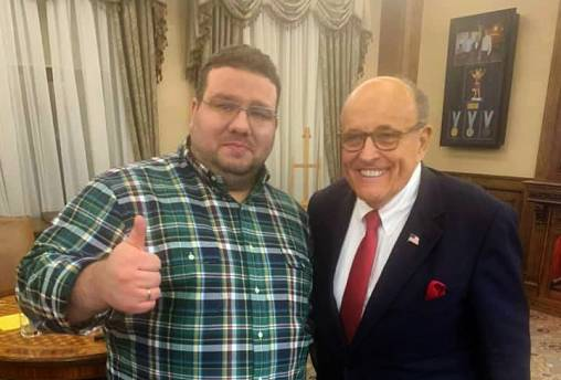Ukrainian former diplomat Andrii Telizhenko and Rudolph Giuliani pose for a