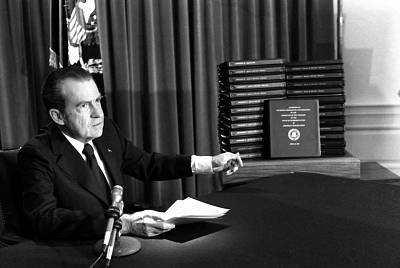 President Richard Nixon gestures toward transcripts of White House tapes after announcing he would turn them over to House impeachment investigators and make them public in April of 1974.