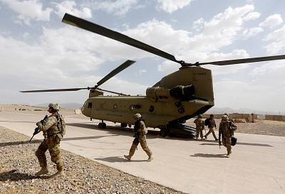 U.S. troops walk from a Chinook helicopter in Uruzgan province in July, 2017.