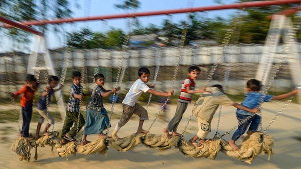 Image: Rohingya children play at a playground at Jamtola refugee camp in Uk