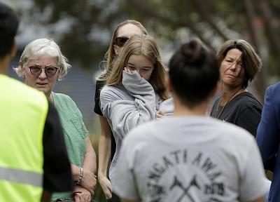 Family of volcano victim Hayden Marshall-Inman, walks from a meeting with Police Minister Stuart Nash and officials in Whakatane, New Zealand, on Dec. 12, 2019.