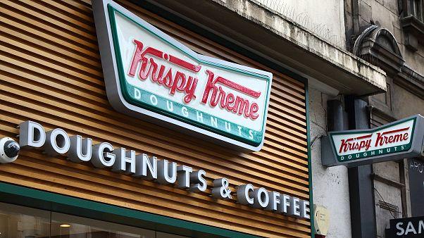 Image: Krispy Kreme store and brand logo seen in London, UK