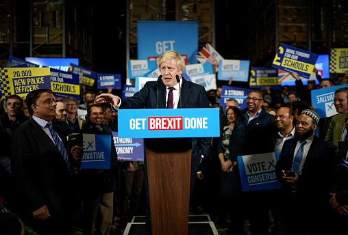 Image: British Prime Minister Boris Johnson speaks to supporters at a facto