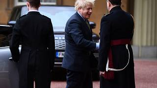 Image: Prime Minister Boris Johnson is greeted by the Queen's Equerry-in-Wa