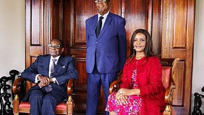 A cake and well wishes: Low-key birthday expected for Mugabe