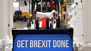 Image: Britain's Prime Minister Boris Johnson drives a Union flag-themed JC