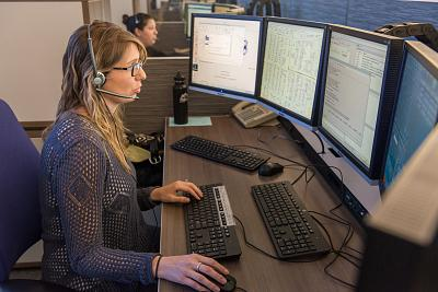 A dispatcher at Seattle Police Department\'s 911 center.