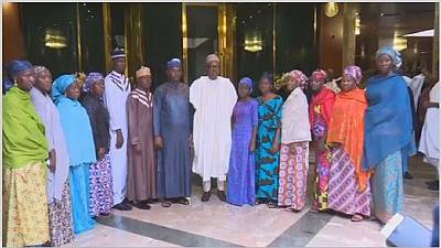 Buhari meets 3 lecturers and 10 police officers freed by Boko Haram
