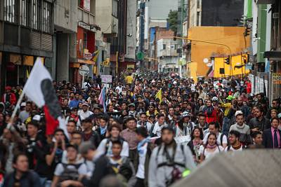 People protest against a tax reform currently being discussed in Colombia on Dec. 16, 2019, in Bogota, Colombia.