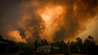 Image: Bushfires approach a home on the outskirts of the town of Bargo near