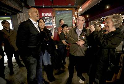 Democratic presidential candidate Sen. Cory Booker with his girlfriend, actress Rosario Dawson, at an event at Smokestack in Dubuque, Iowa, on Dec. 8, 2019.