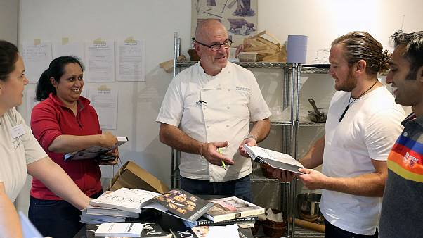 Image: French Chef Richard Bertinet signing copies of his cookery books for