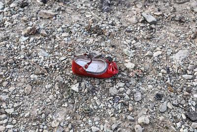 A child\'s shoe at the crash scene of a Ukrainian airliner near Imam Khomeini airport nearTehran on Wednesday.