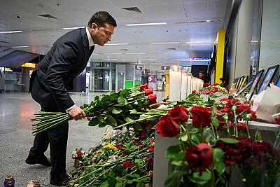 President Volodymyr Zelensky places flowers at a memorial for the plane crash victims at the Boryspil airport outside Kiev on Thursday.