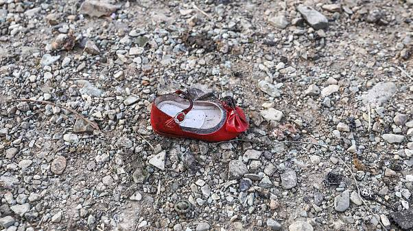 Image: A child's shoe at the scene of a Ukrainian airliner that crashed sho
